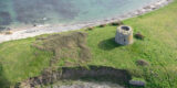 Oblique aerial image of the Martello tower situated on the north end of Shenick's Island.