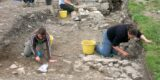 Archaeologists excavating a site.