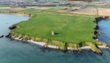 Oblique aerial image of Drumanagh Promontory Fort and Martello Tower, North County Dublin