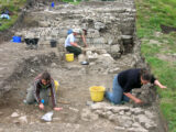 Excavation of the stone tower uncovered within the mound in Tulsk, Co. Roscommon. Image shows archaeologists at work on the partially excavated site.